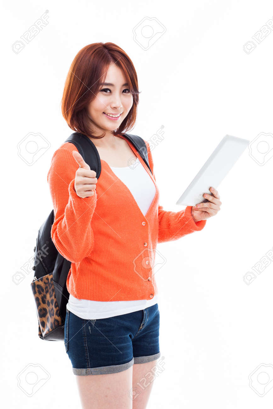 Young Asian student woman using a pad PC isolated on white background. Stock Photo - 25024570