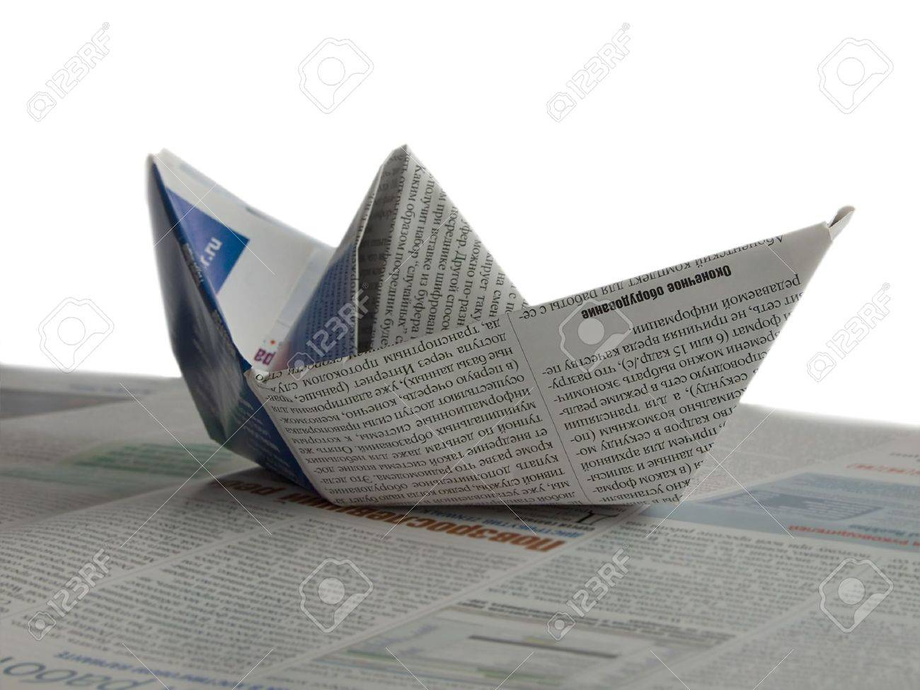 Newspaper Origami Boat Isolated On White Stock Photo