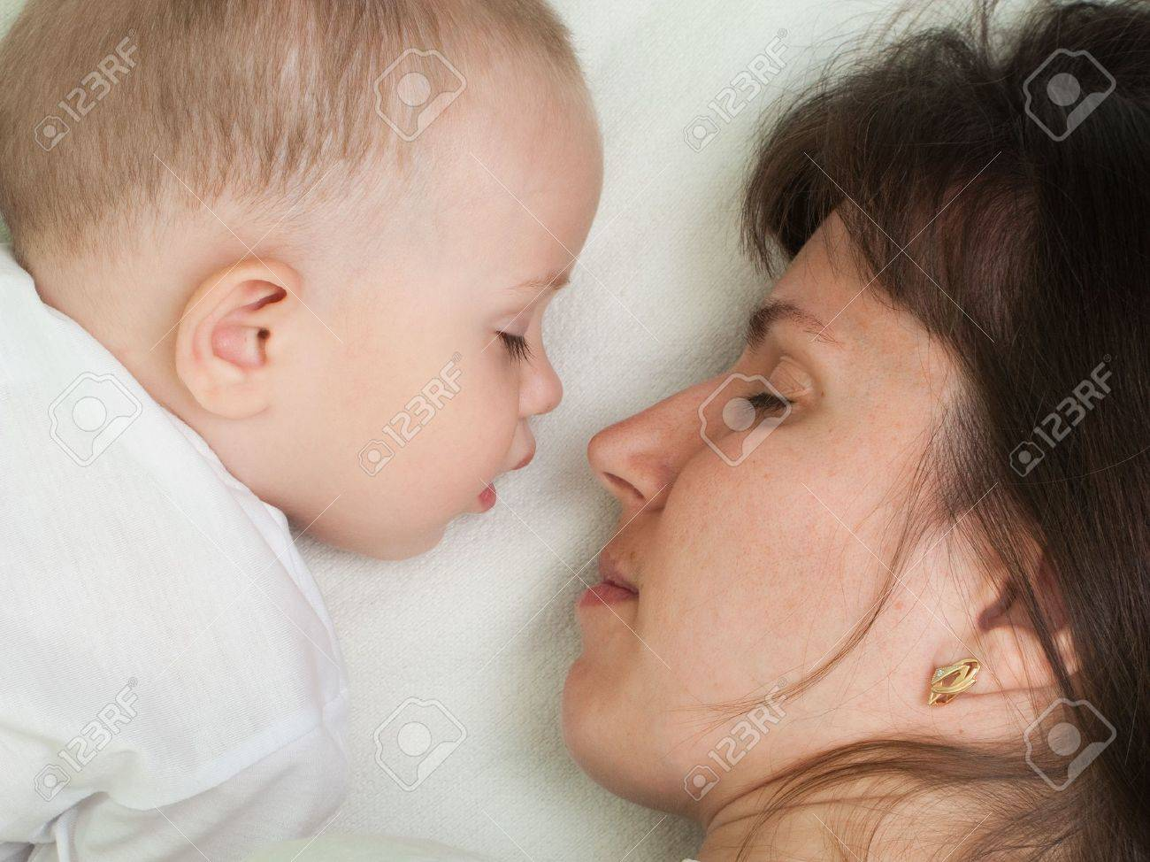 Sleeping mother and cute child in family love life Stock Photo - 5303340