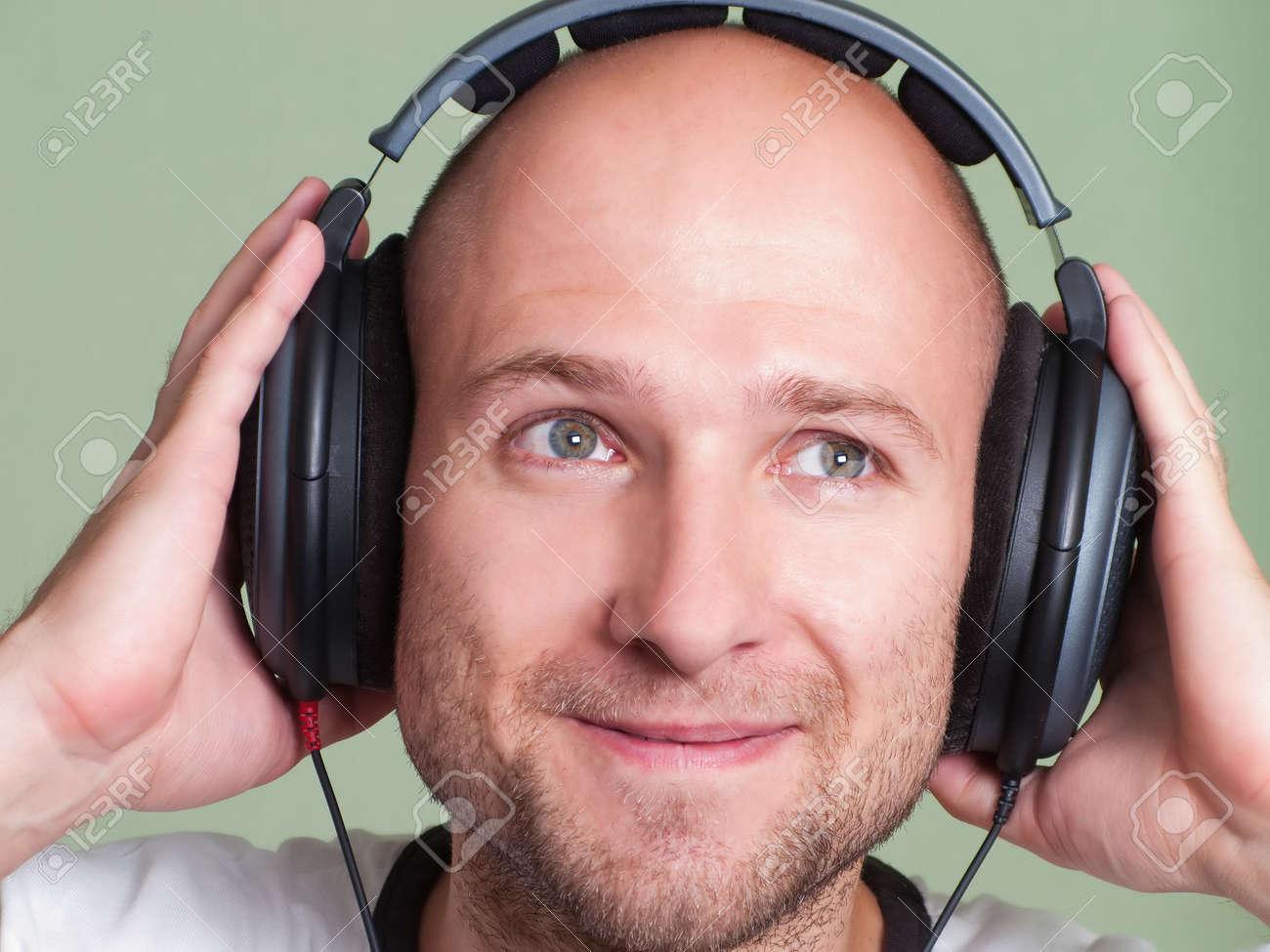 Adult men in sound headphones listening mp3 music Stock Photo - 5313798