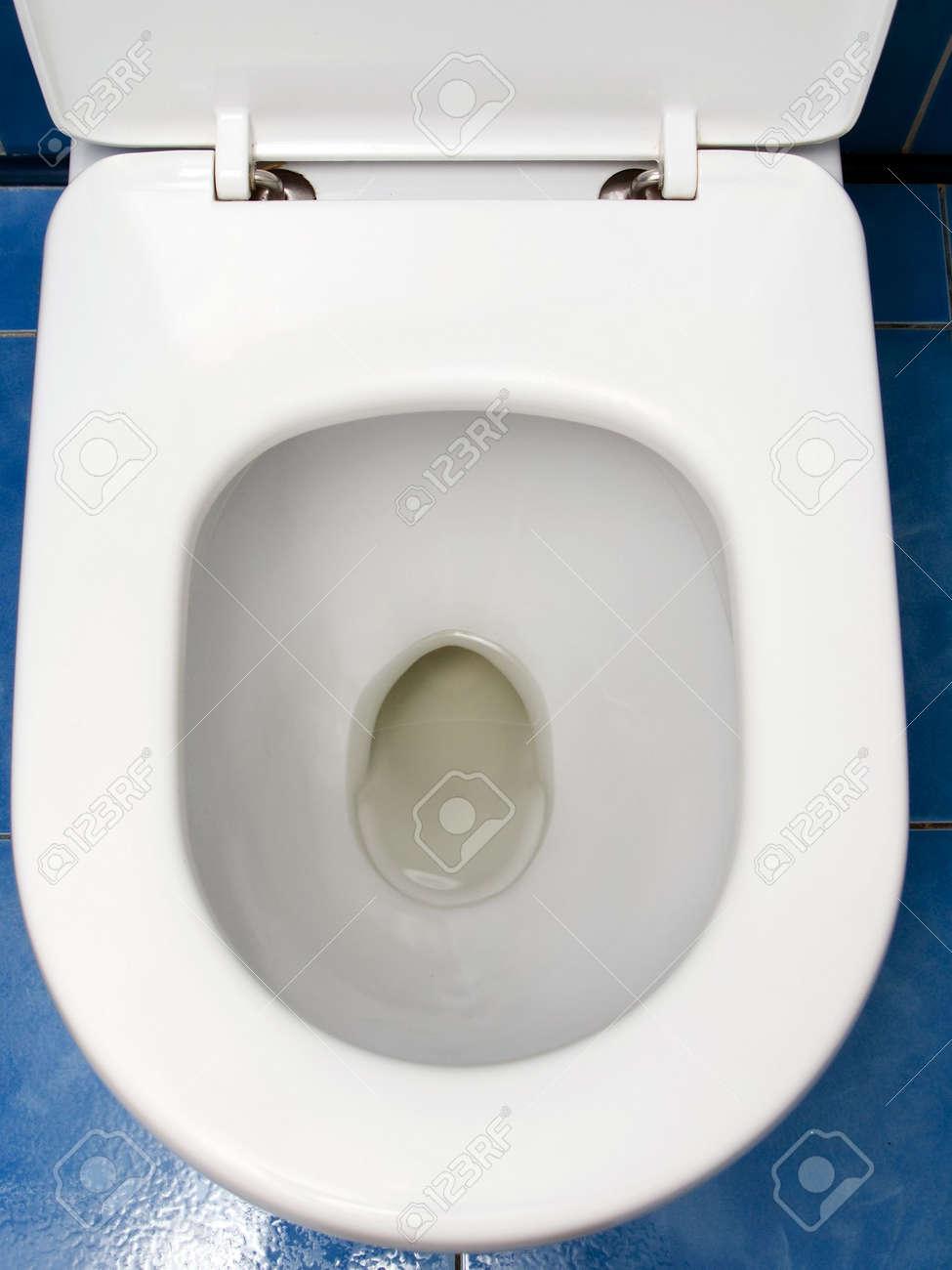 Home interior clean toilet sink bowl on tile floor Stock Photo - 5638827