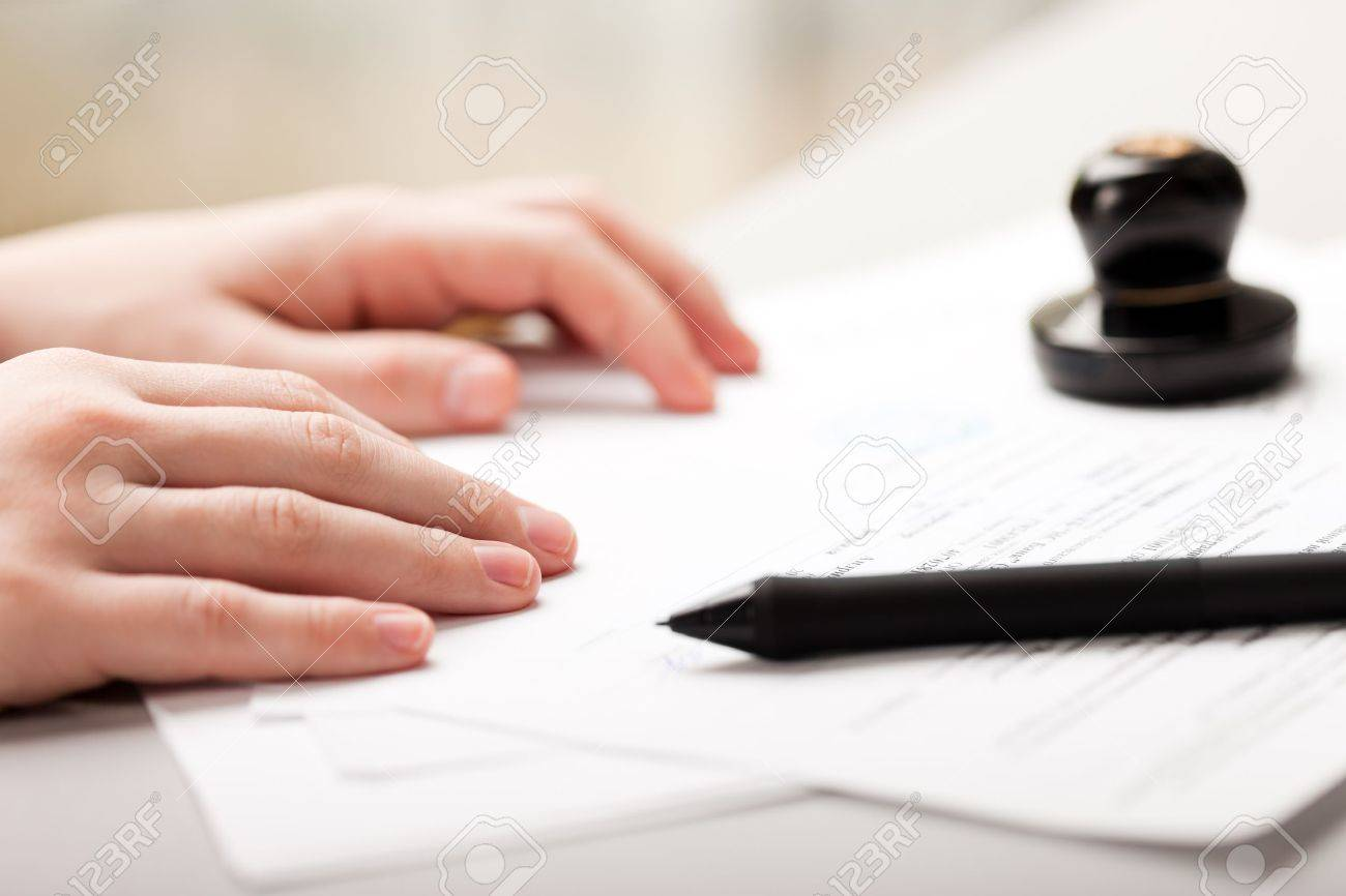 human business men hand pen writing paper document stock photo