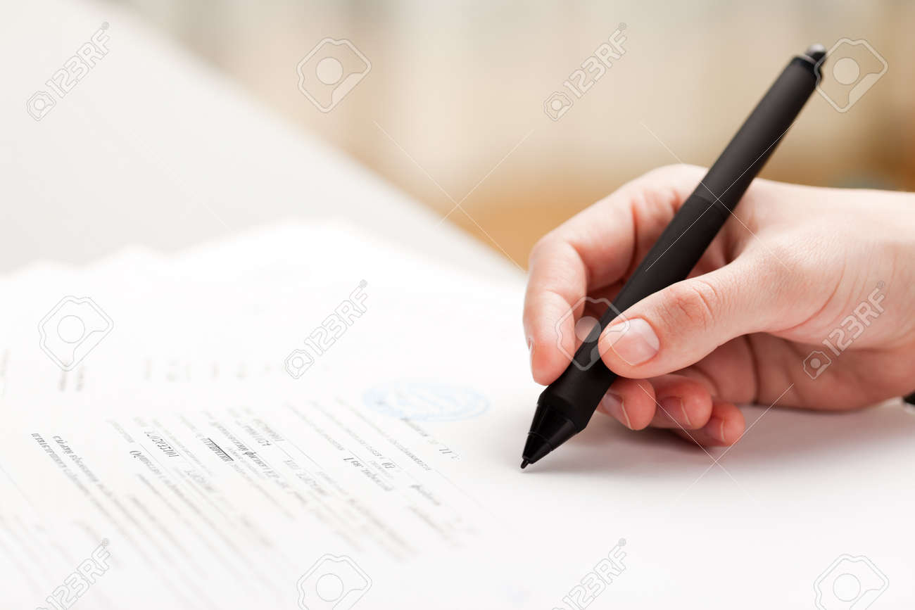 Human business men hand pen writing paper document Stock Photo - 9196480