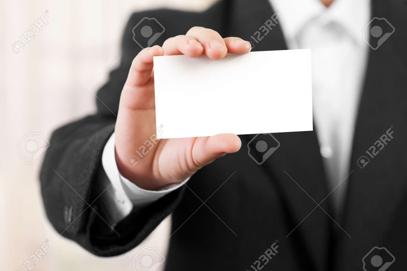 Business men hand holding white empty blank card Stock Photo - 9682891