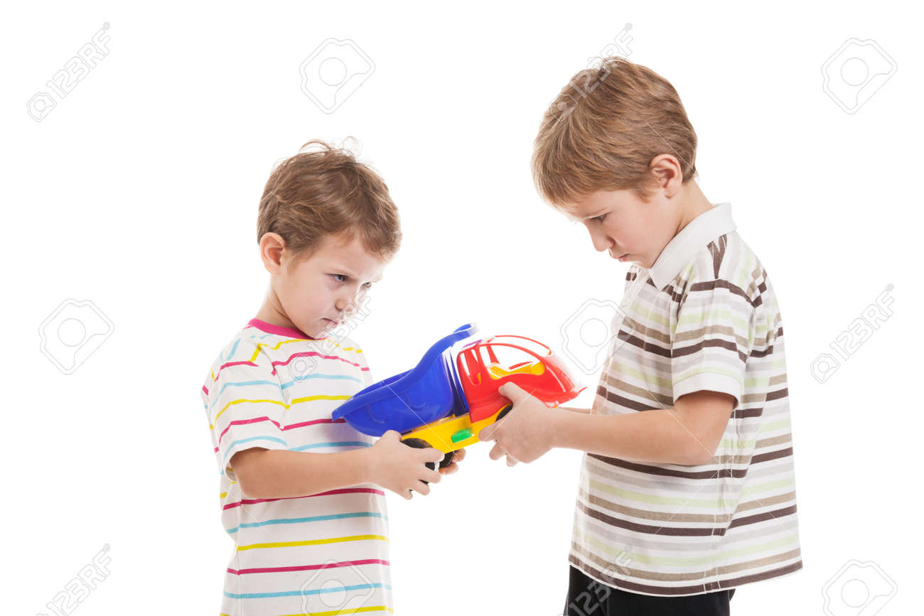 Two Little Displeased Child Boy Brothers Fighting For Toy In Family Conflict Stock Photo