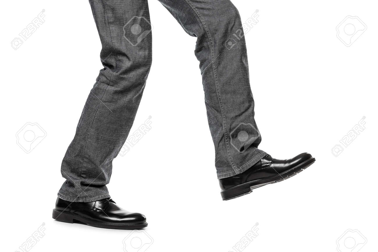 Business man in black shoes walking for next achievement or promotion step white isolated Stock Photo - 17894647