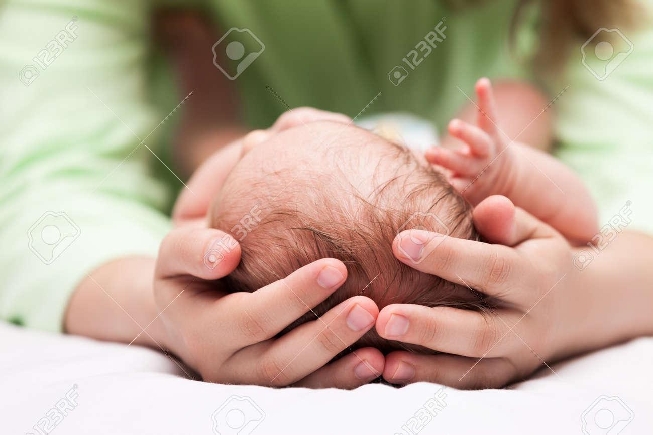 88ef1b9888b Loving mother hand holding cute sleeping newborn baby child Stock Photo -  20487730