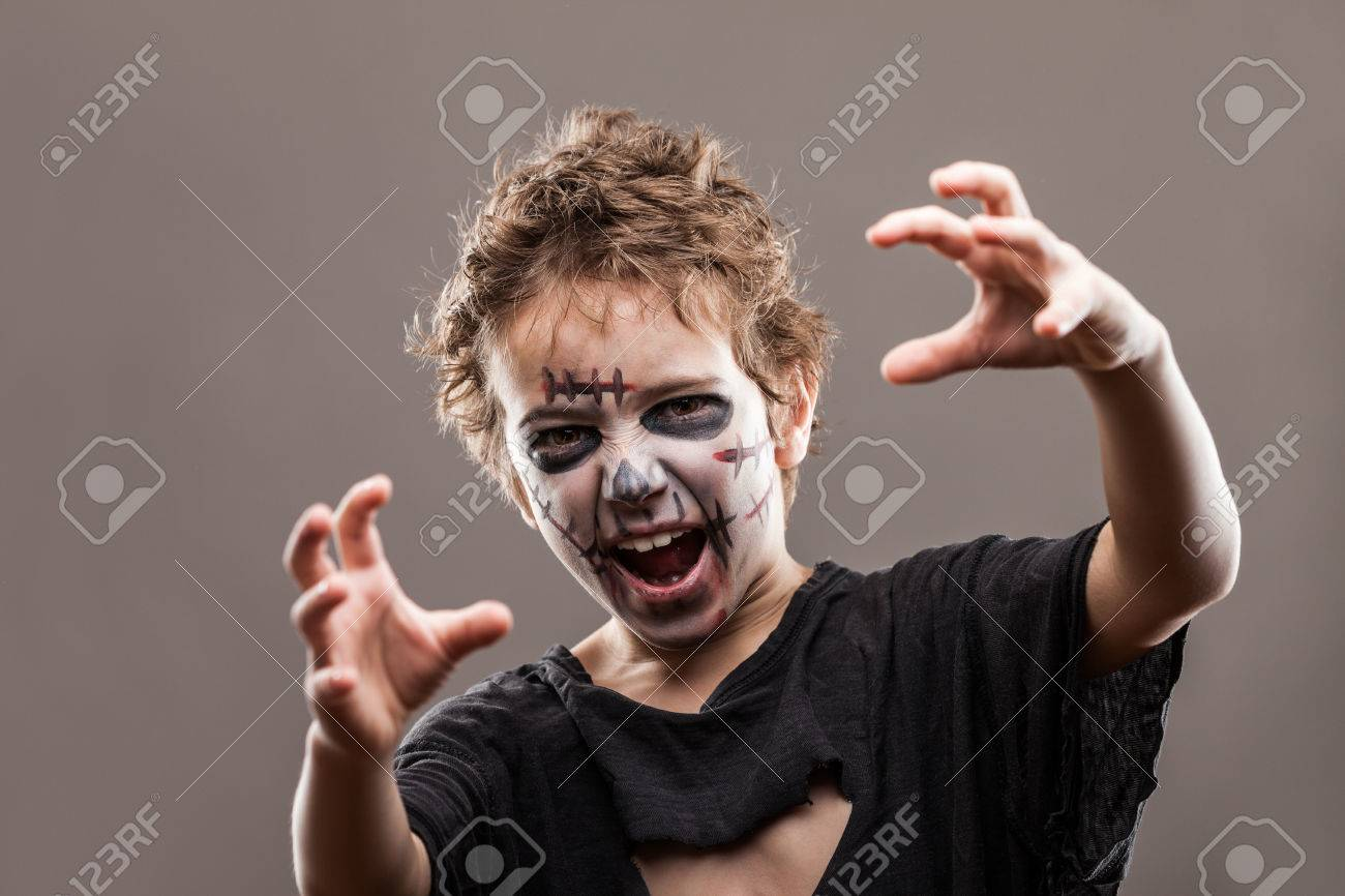 Halloween or horror concept - screaming walking dead zombie child boy reaching hand - 36588144