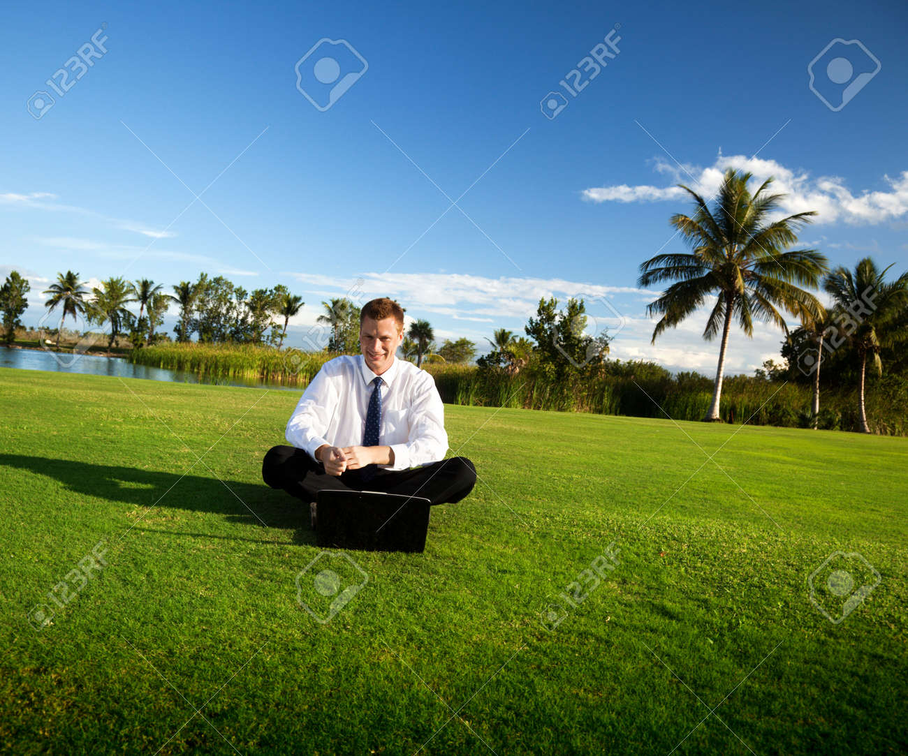 happy young businessman and sunset Stock Photo - 6330768