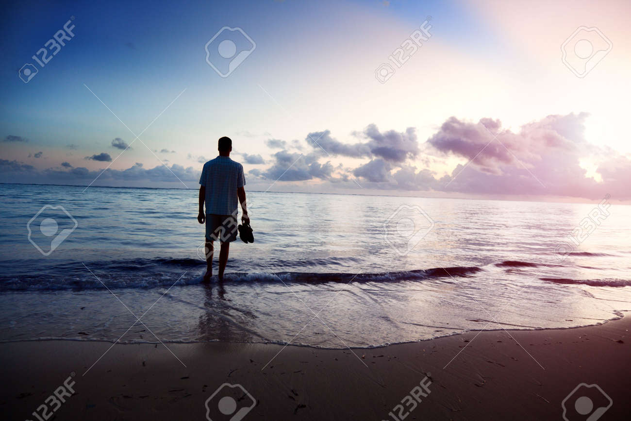 young man and sunset on sea Stock Photo - 6436329