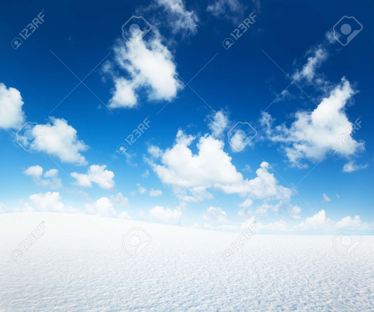 field of winter snow and perfect blue sky Stock Photo - 6596845