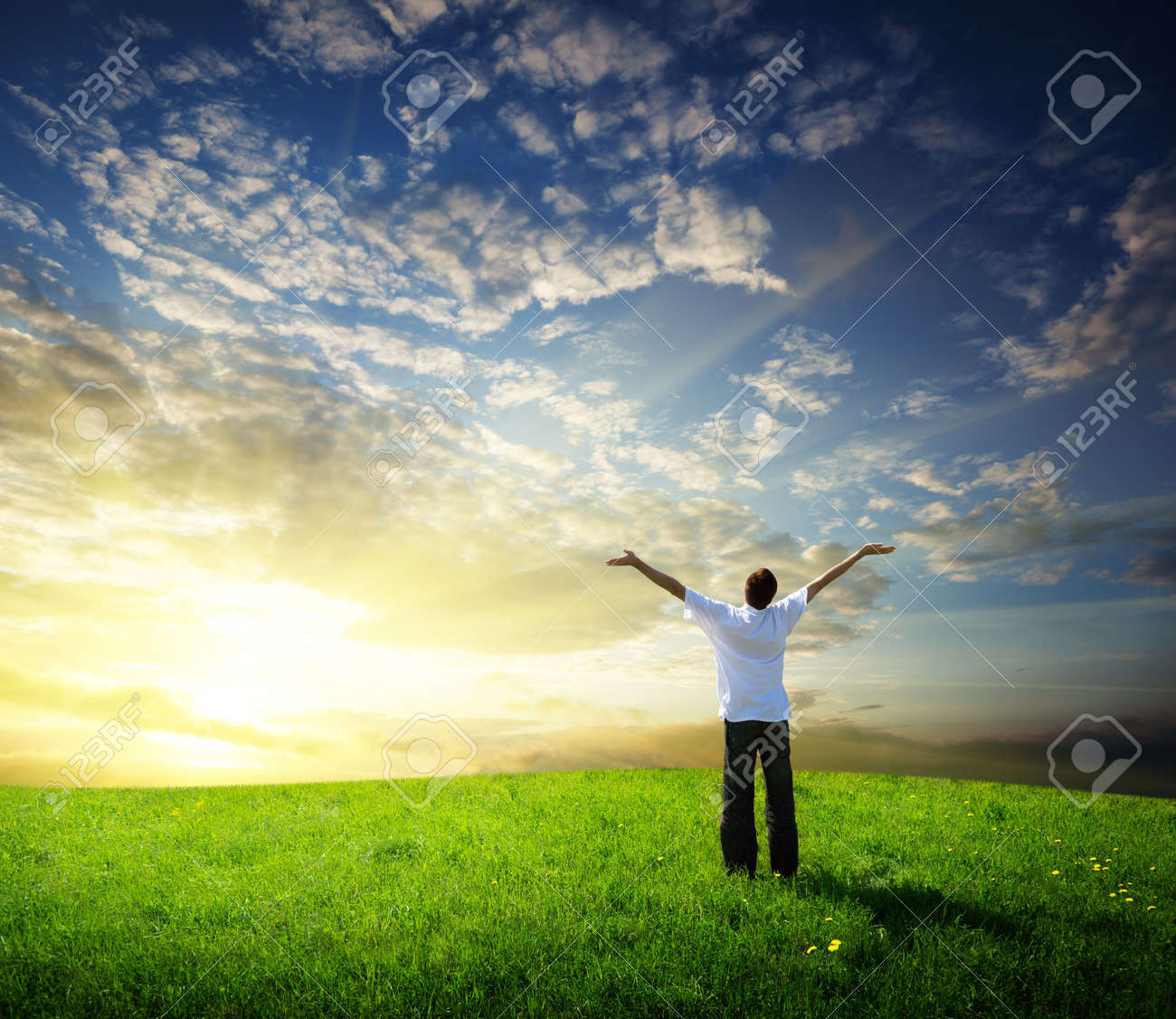 field of grass and happy young man Stock Photo - 6714612