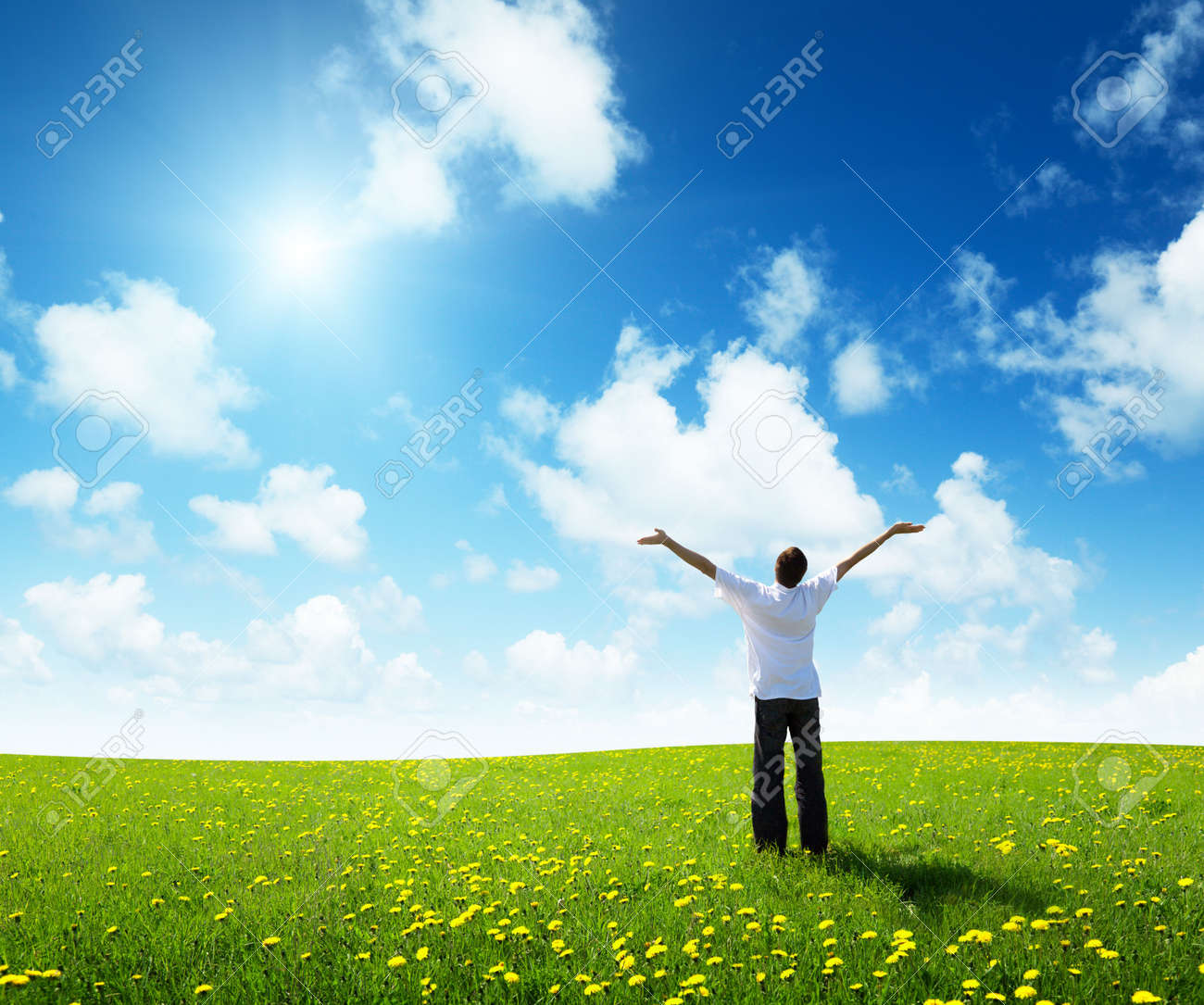 field of grass and happy young man - 6738192