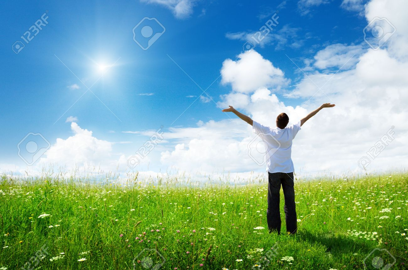 field of grass and happy young man Stock Photo - 6777016
