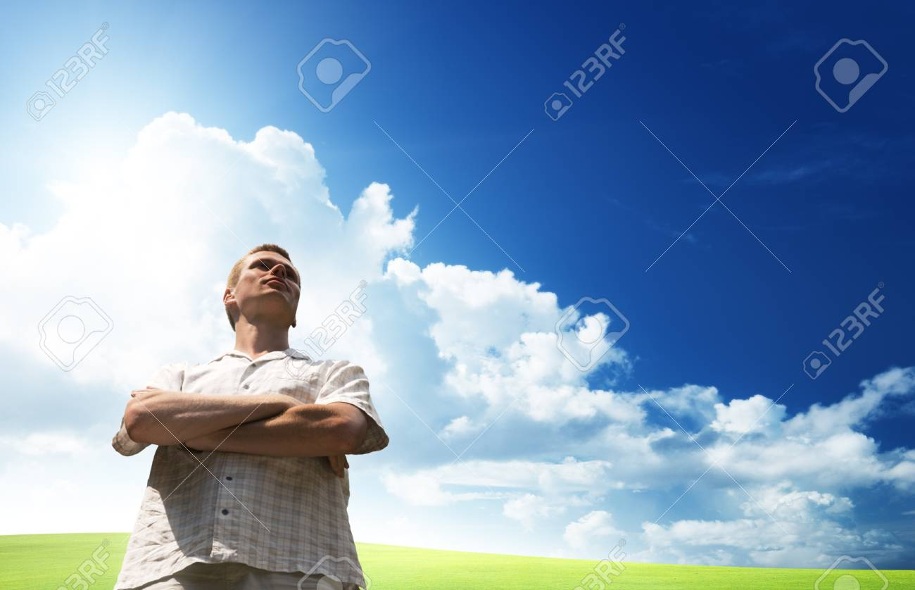 field of grass and happy young man Stock Photo - 8084745