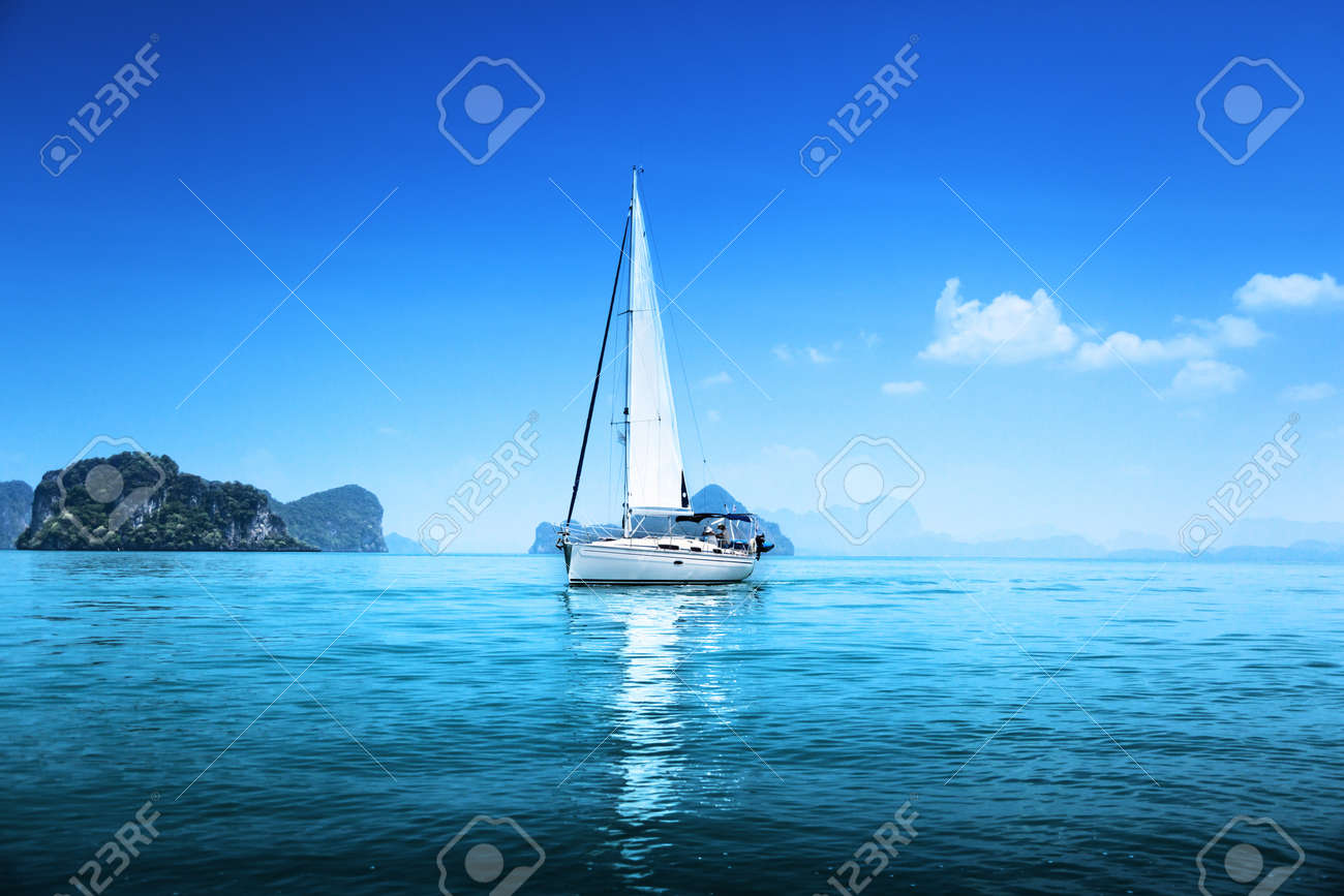 yacht and blue water ocean - 16306728