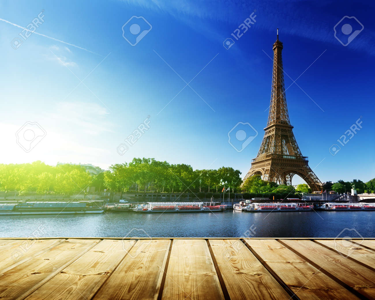background with wooden deck table and  Eiffel tower in Paris Stock Photo - 20191580