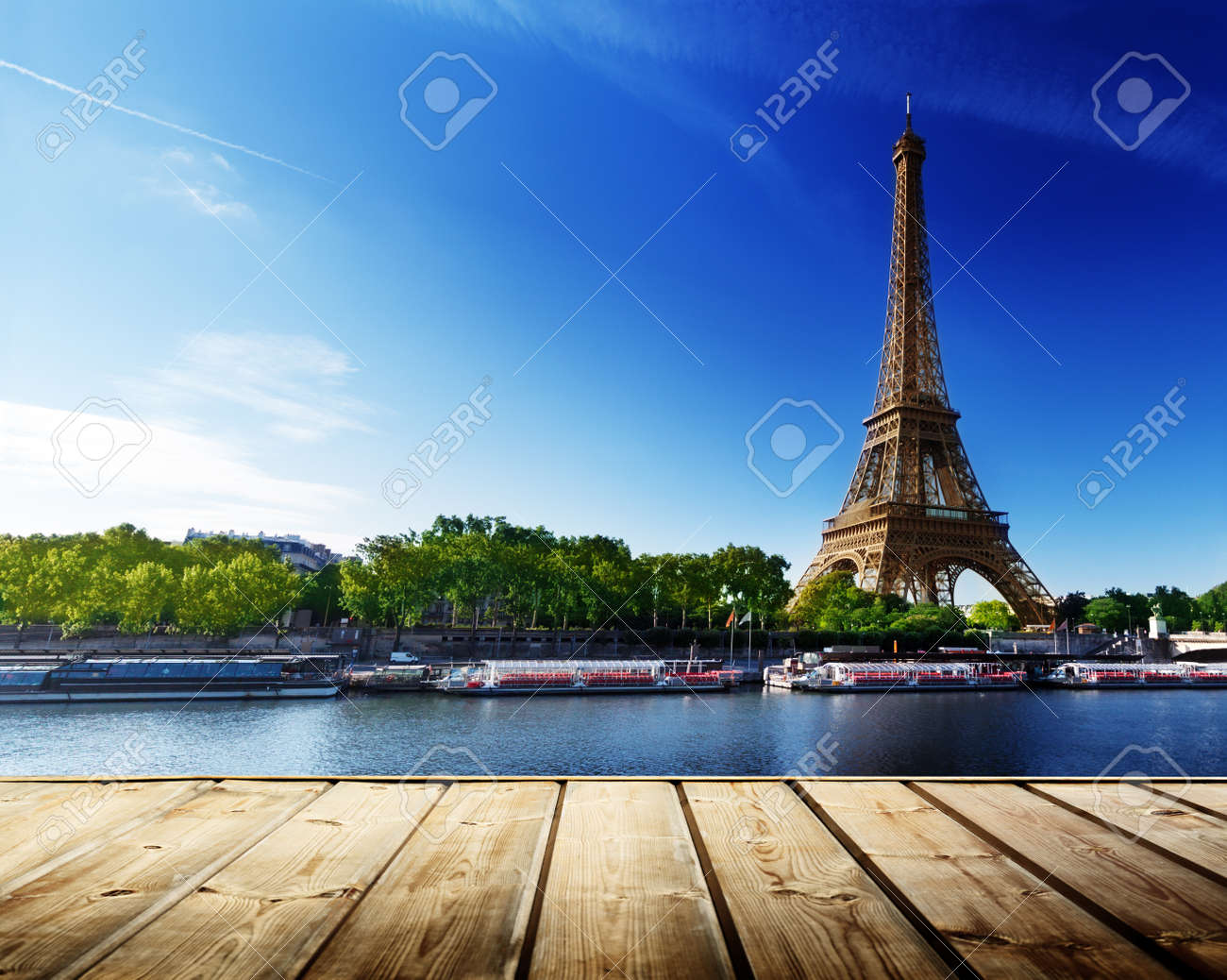 background with wooden deck table and Eiffel tower in Paris - 21057785