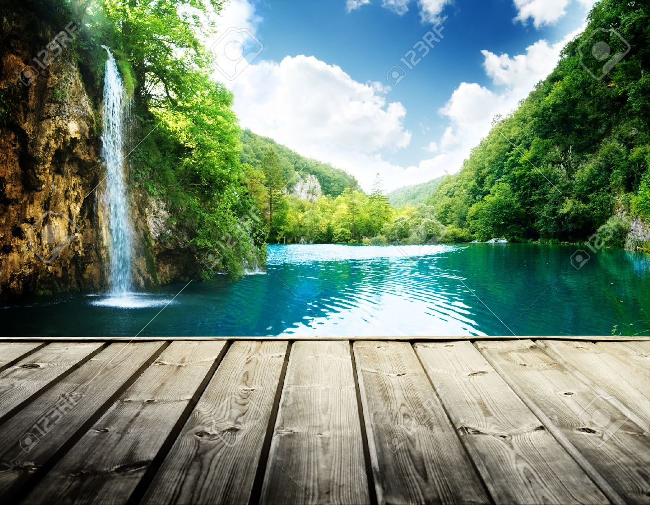 waterfall in deep forest of croatia and wood pier - 21490690