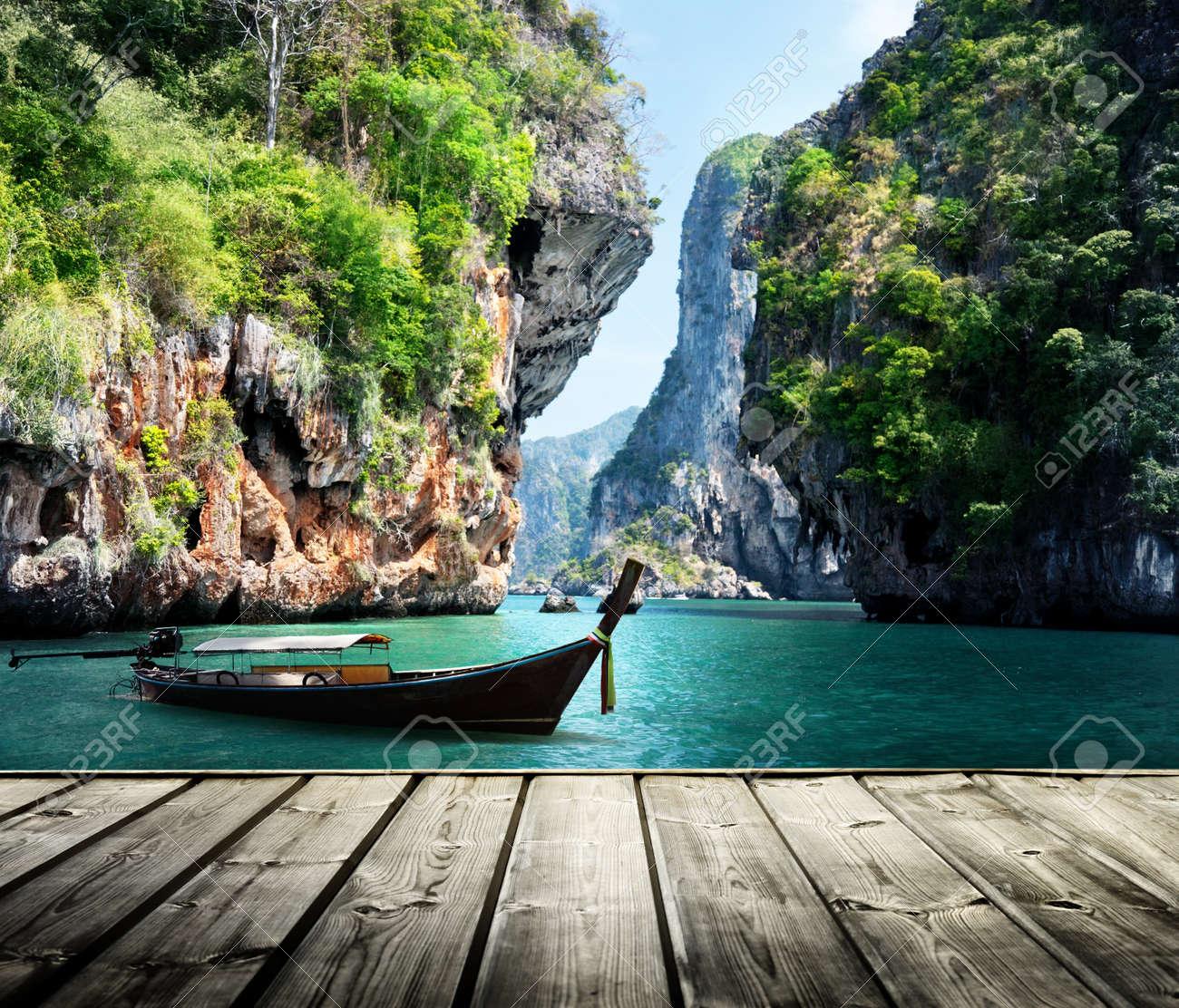 long boat and rocks on railay beach in Krabi, Thailand Stock Photo - 22109654