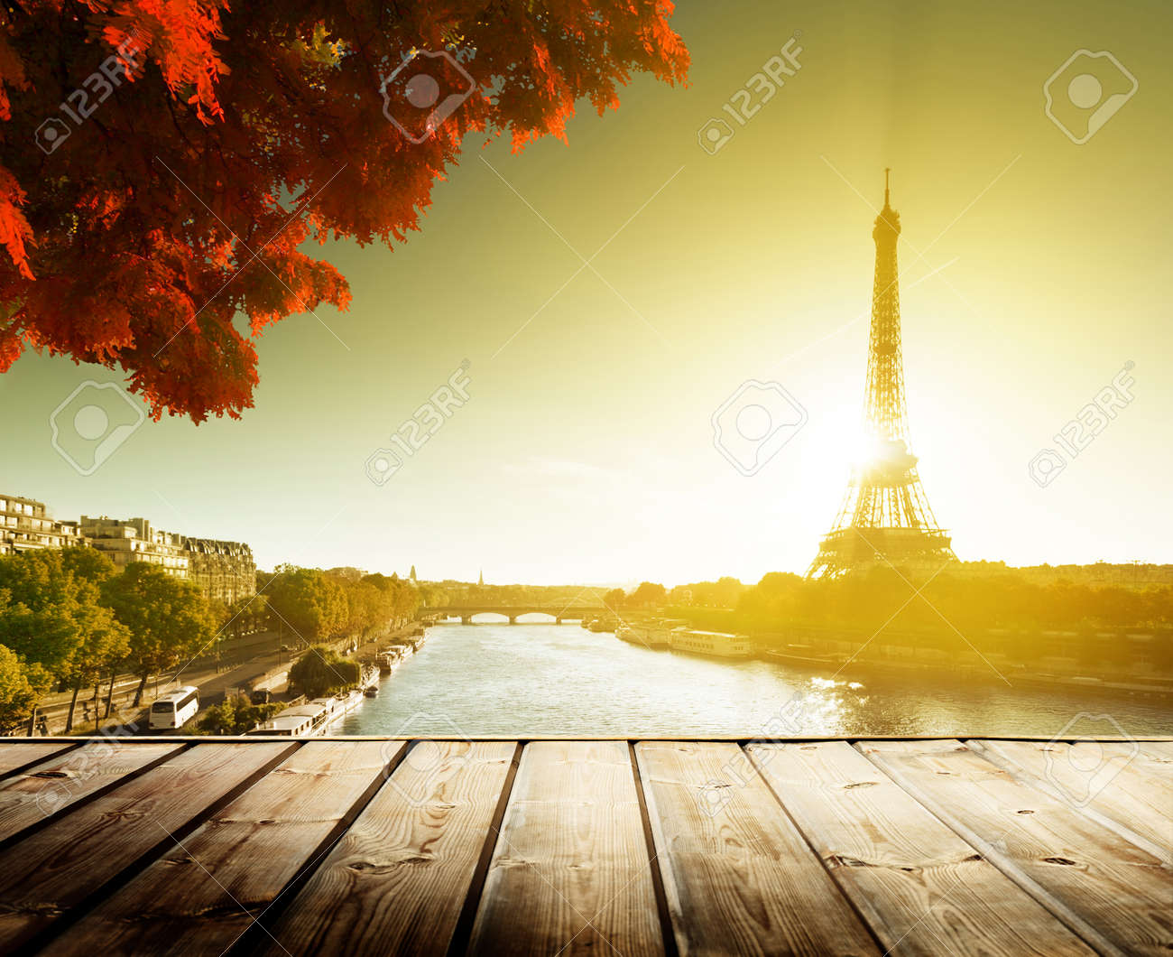 wooden deck table and  Eiffel tower in autumn Stock Photo - 22936269