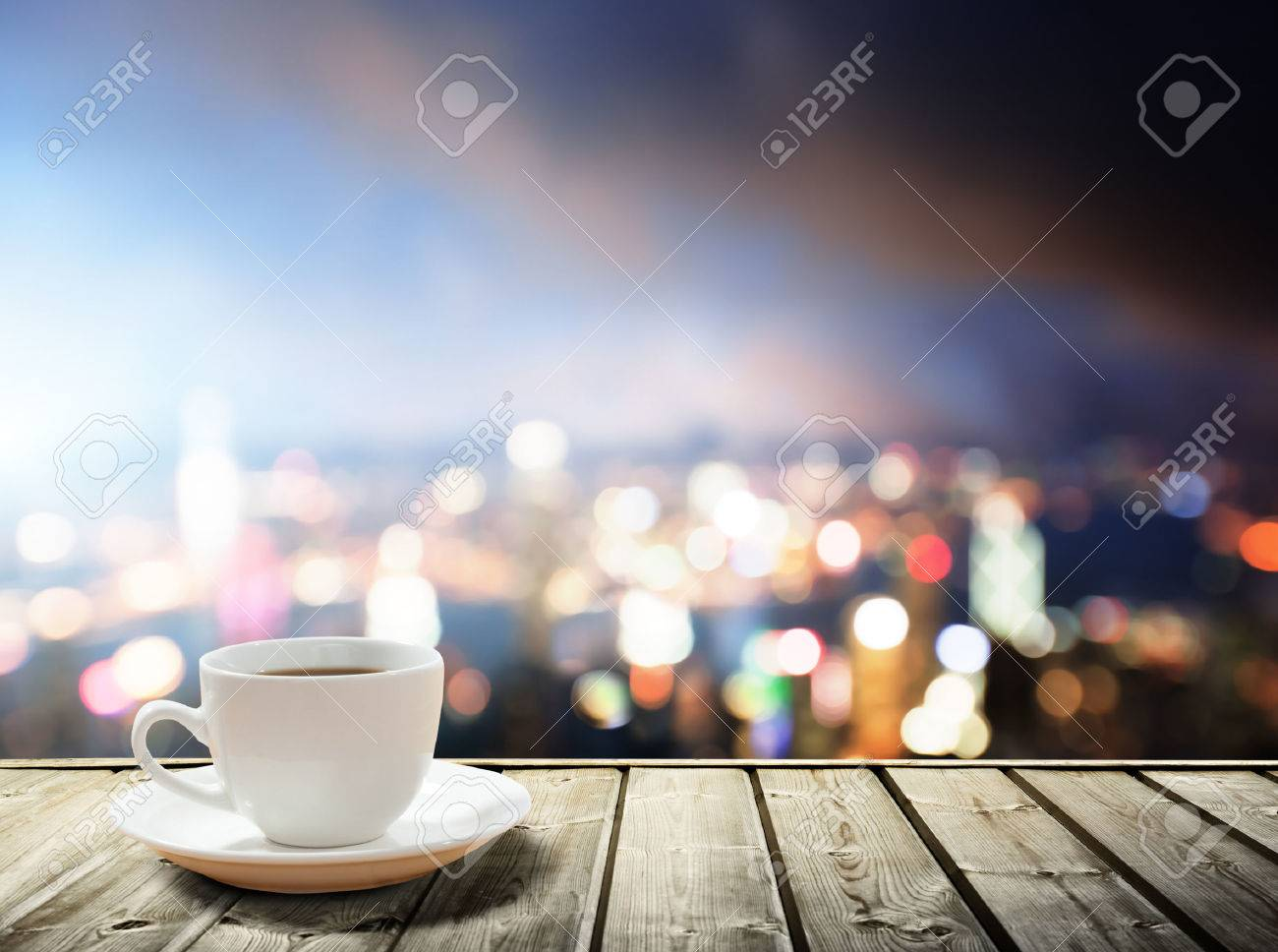 coffee on table in the night city stock photo, picture and royalty