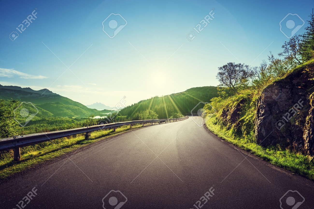 summer road in mountain, Lofoten islands, Norway - 49266044