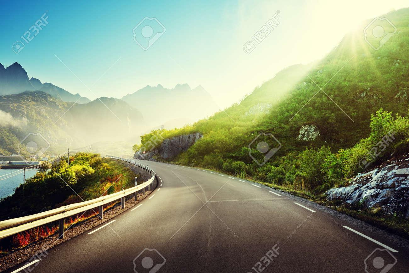 road and mist, Lofoten islands, Norway - 55481875