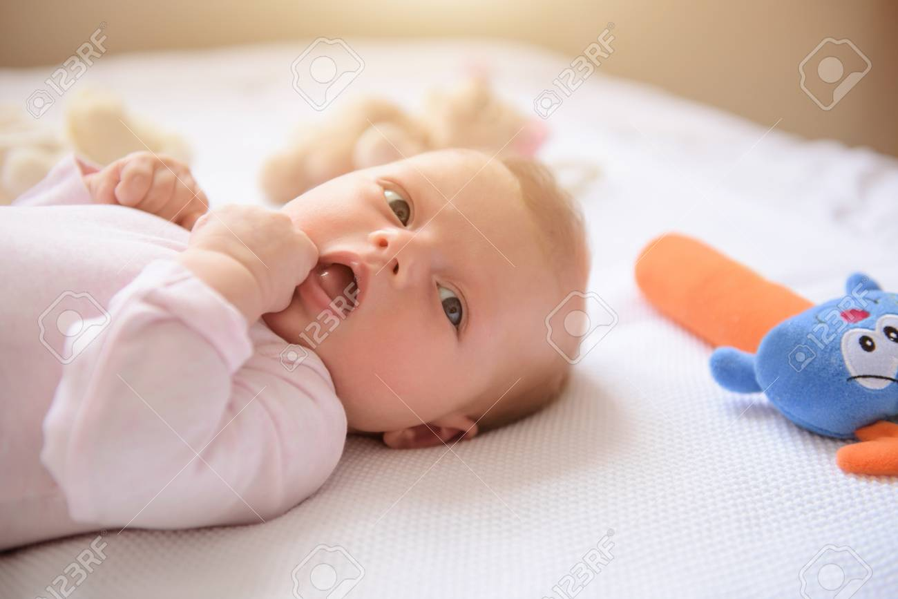 so cute and small. close up of cute baby girl lying down with