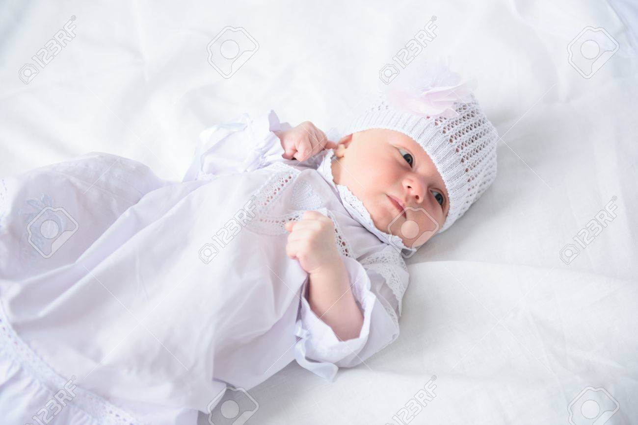 41fb188f1a6 Sleepy little angel. Top view of cute little baby wearing in white dress  and knitted