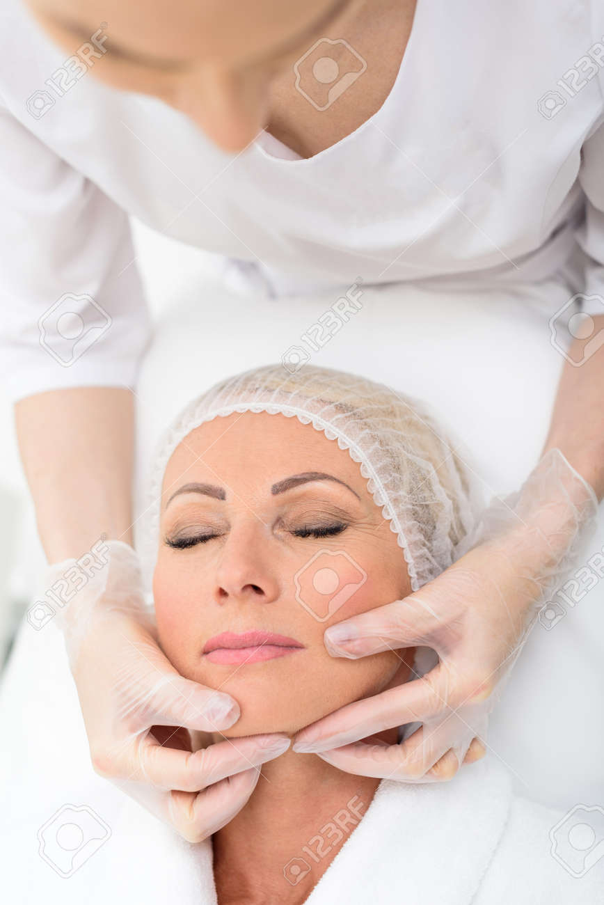 Calm Senior Woman Is Getting Facial Skincare Treatment At Beauty Stock Photo Picture And Royalty Free Image Image 64895350
