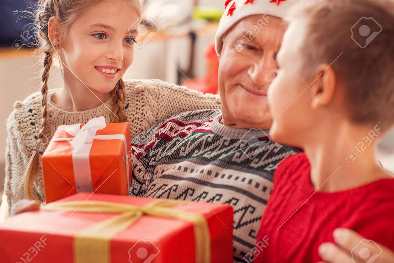 Mature Grandfather Is Sharing Christmas Presents With His ...