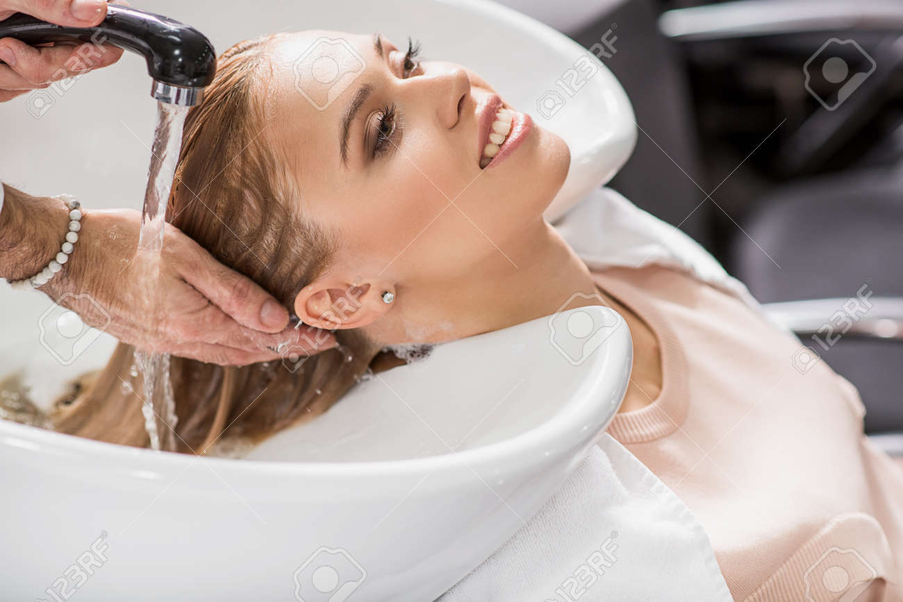 Happy Woman Is Getting New Haircut Stock Photo Picture And Royalty