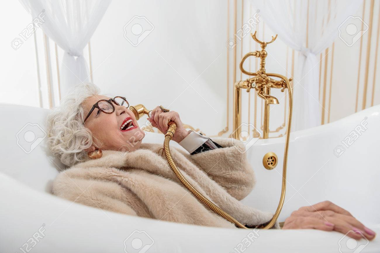 Funny Senior Lady With Fur Coat In Bathtub Stock Photo, Picture ...