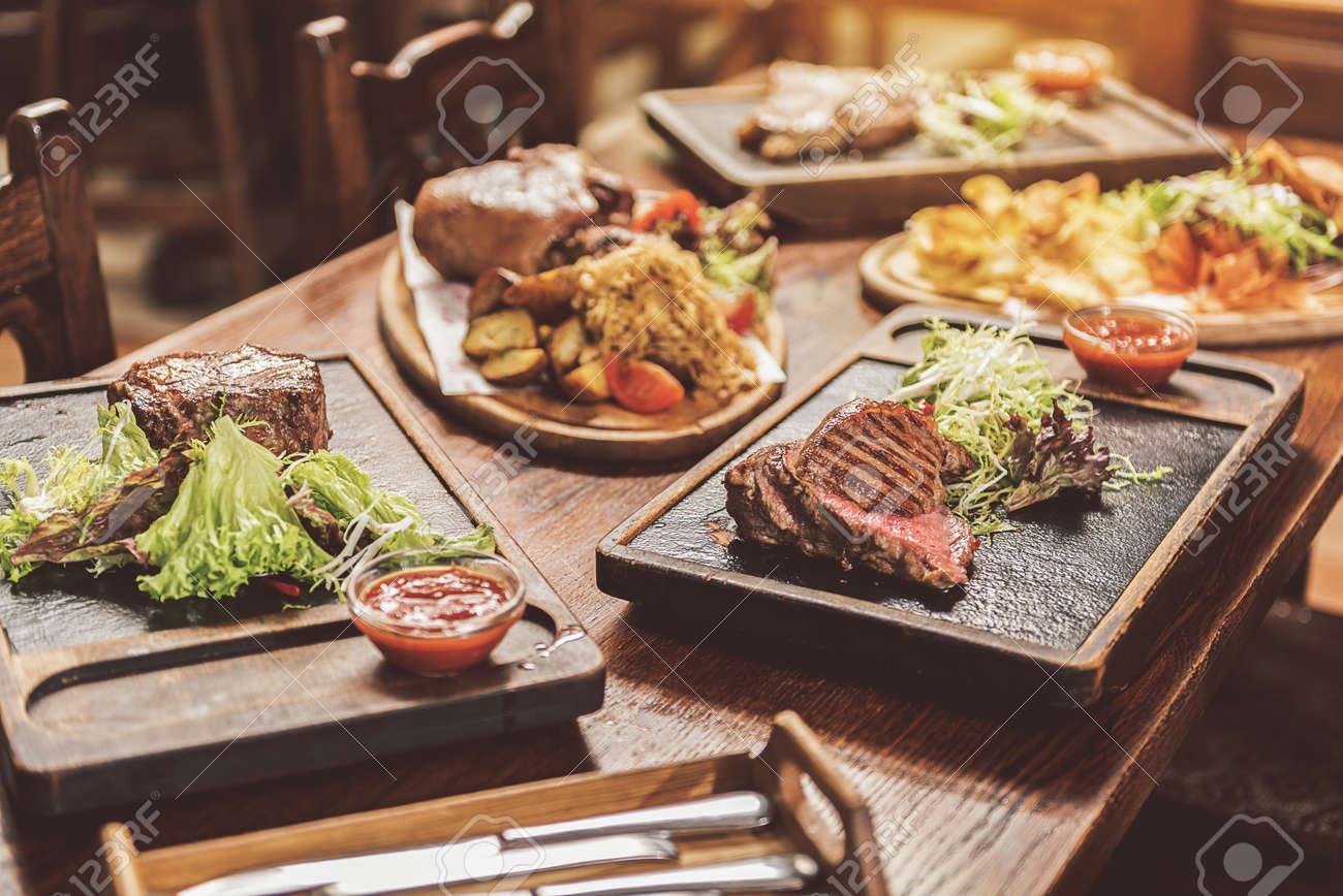 Assortment Of Hearty Dishes Served In Pub Stock Photo Picture And