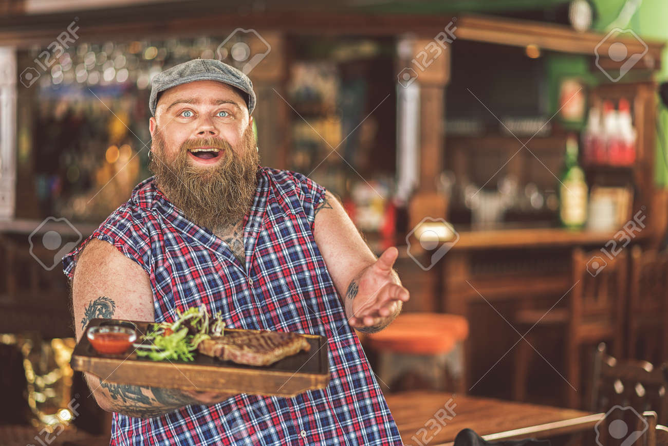 78811258-smiling-fat-guy-posing-with-steak.jpg