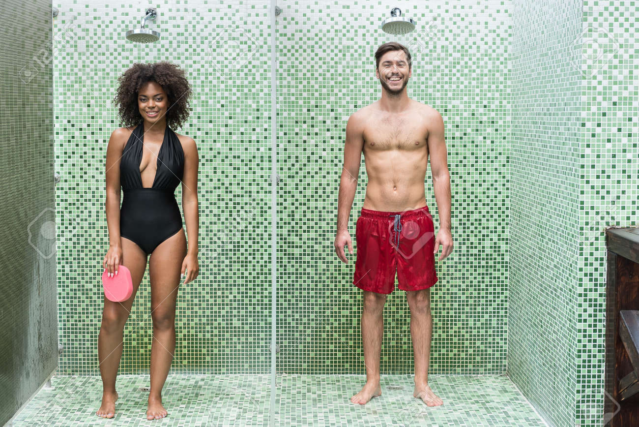 f749753acf4 Cheerful youthful couple enjoying cleaning body in douche Stock Photo -  83156591