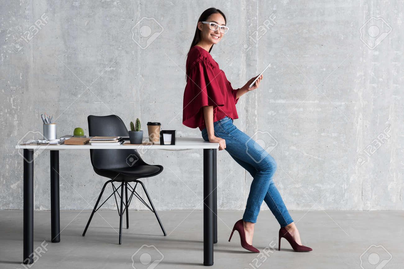 Cheerful woman enjoying her business work - 88203531