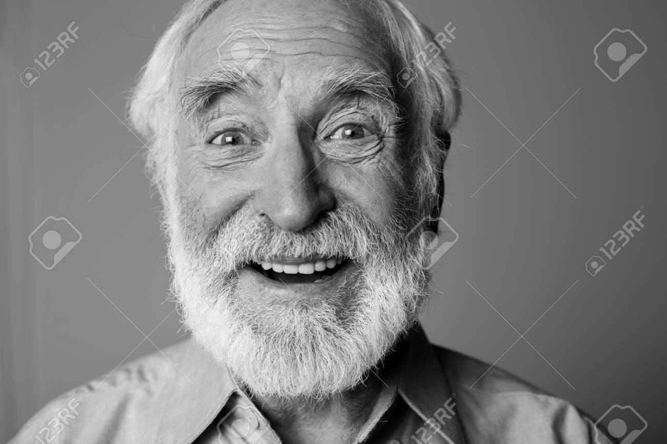 Sincere amazement. Close up black-and-white portrait of aged happy pensioner with widely open eyes while standing. Isolated on grey background - 91857666
