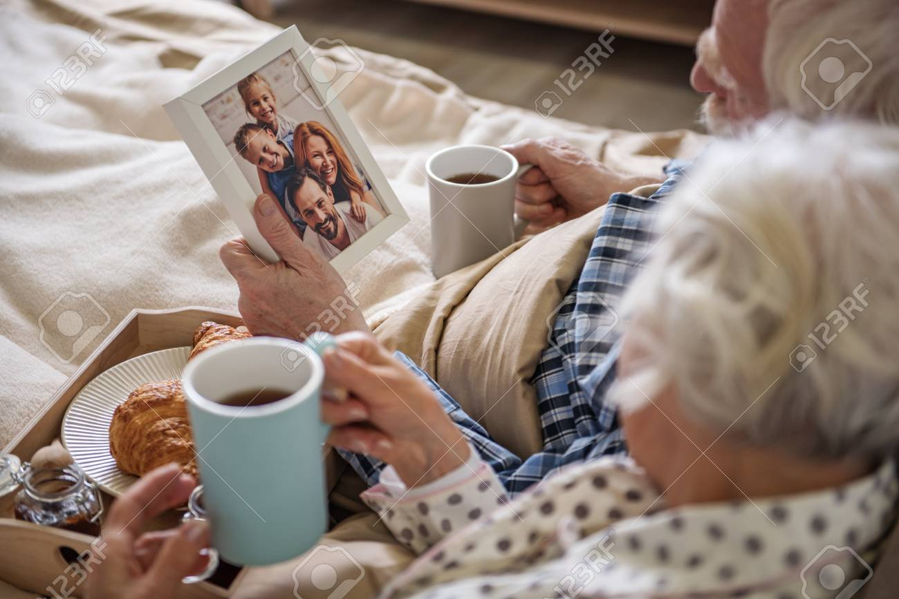 Old Man Holding Frame With Photo. Senior Married Couple Looking ...