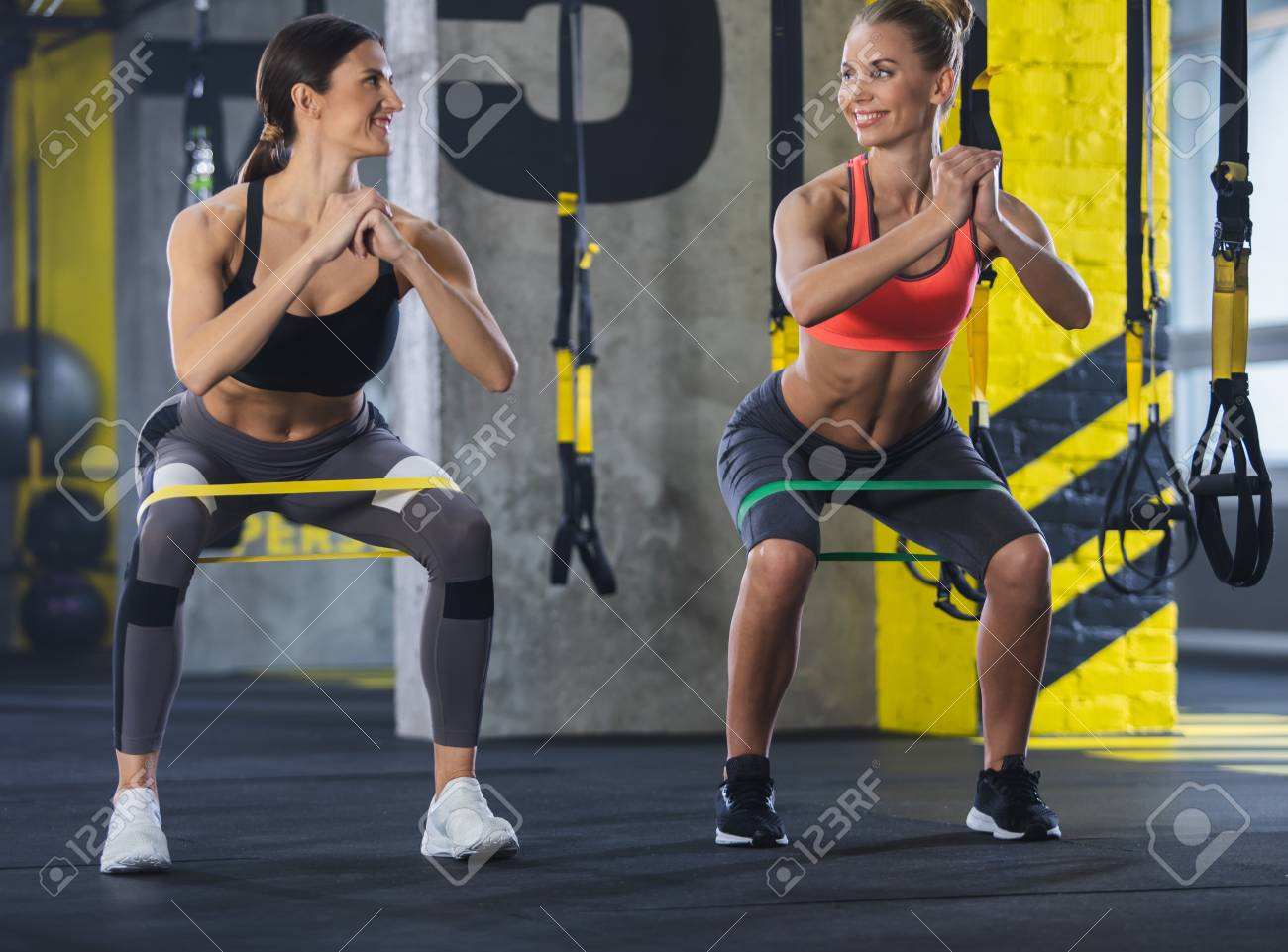 Smiling Shapely Ladies Are Training