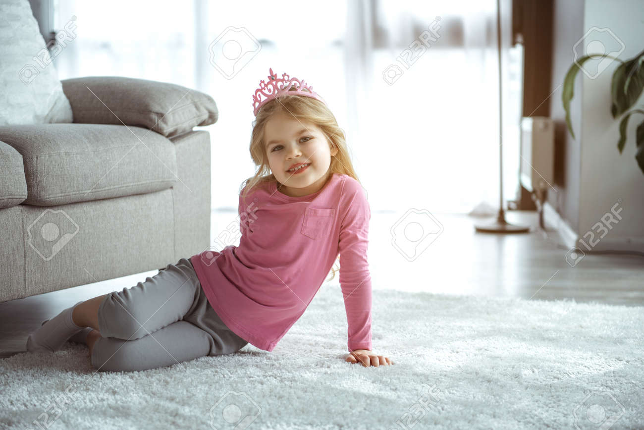 I am future queen full length portrait of dreamful little girl is wearing pink toy