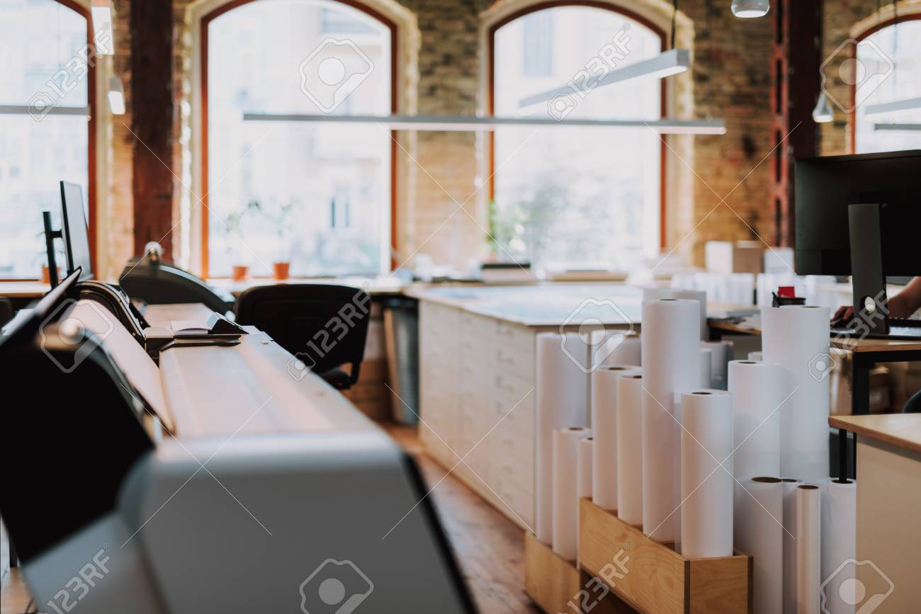 Paper rolls standing on the floor of typography with modern equipment - 111344550
