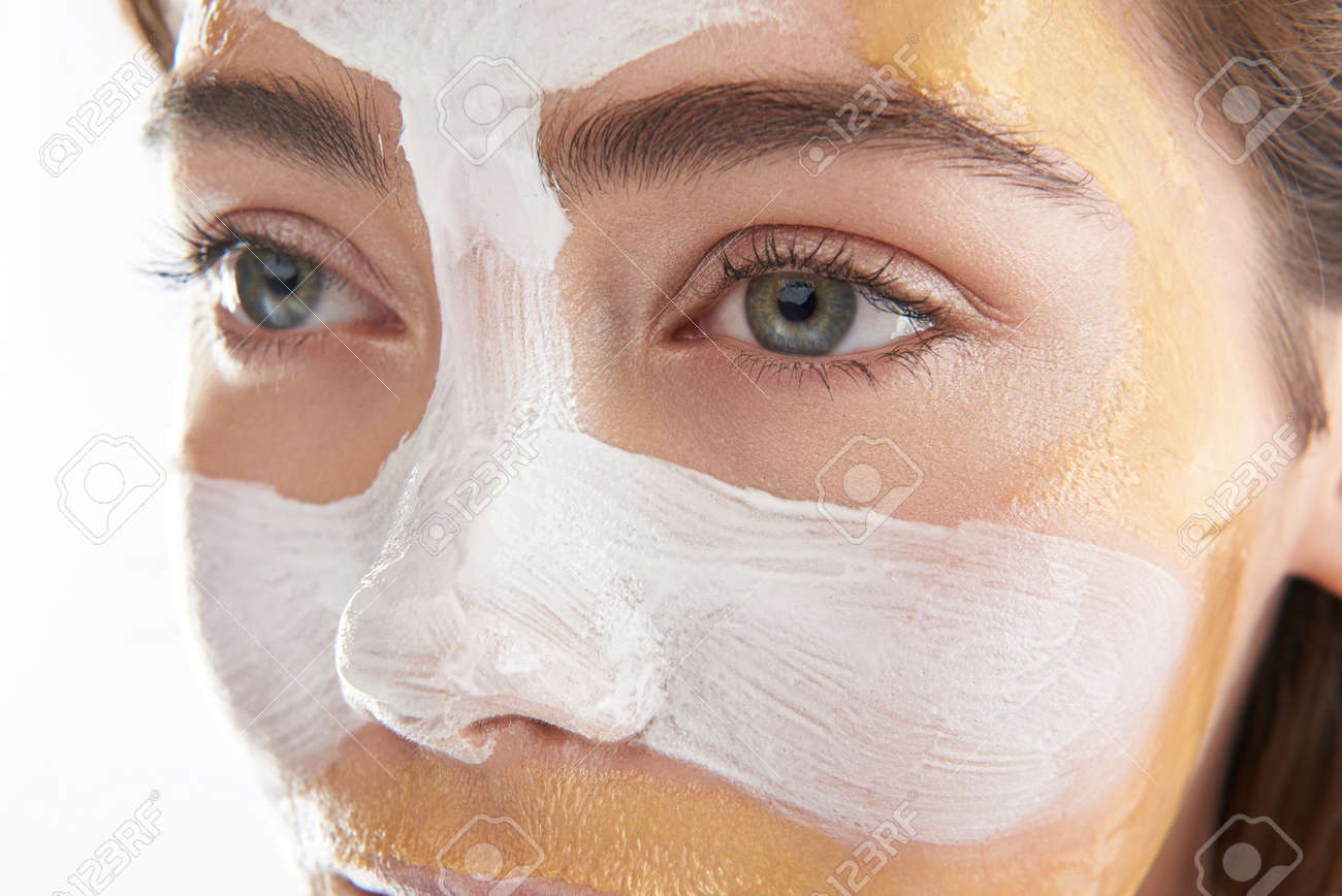 Upper face of pretty woman with cosmetic mask - 121686751
