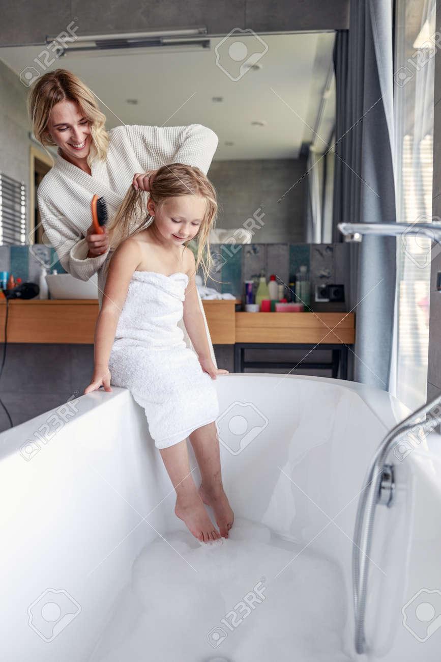 Cute girl with wet hair in the bathroom - 129549957