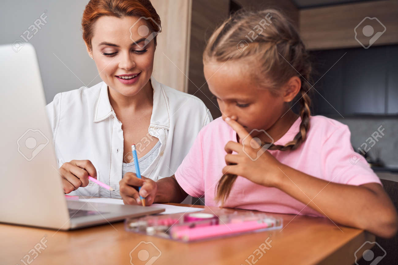 Mother explaining to her smart daughter - 159942293