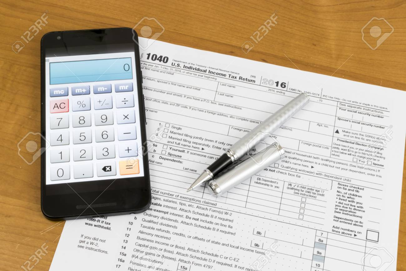 A shot of US Income Tax Return Form 1040 with a calculator on