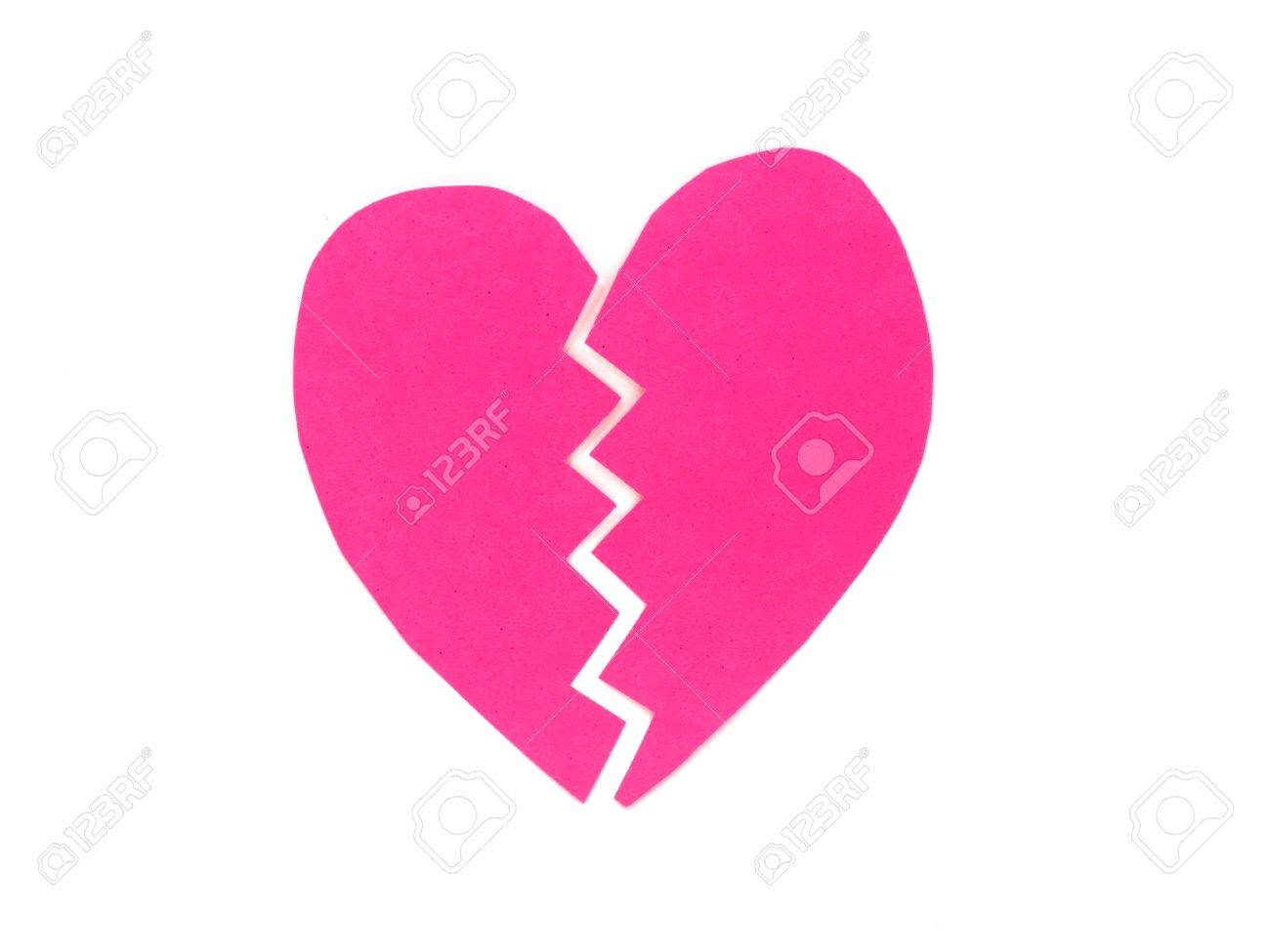 Broken pink heart on white background Stock Photo - 11937761