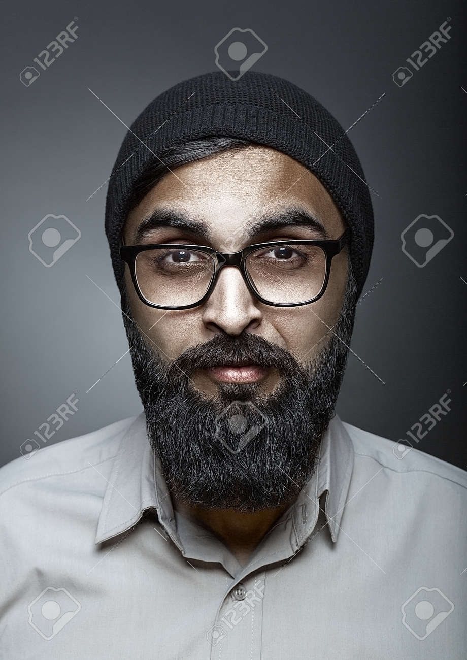 Magnificent High Fashion Portrait Of Man With Beard In Glasses Esquire Style Short Hairstyles Gunalazisus