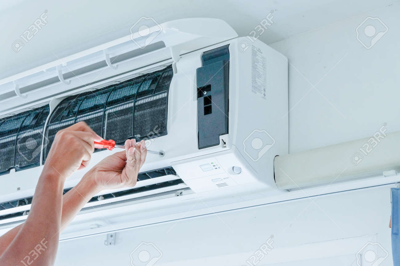 Air conditioner repairing by technician - 145096224
